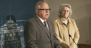Gov. Tim Walz speaks to reporters at a Capitol press briefing as Minnesota Health Department Commissioner Jan Malcolm looks on March 15, 2020. (Staff photo: Kevin Featherly)