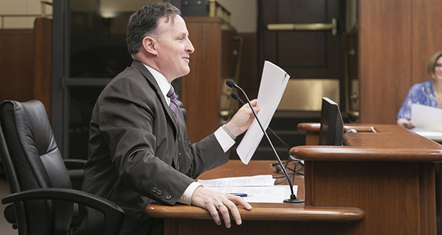 House Judiciary Chair John Lesch, DFL-St. Paul, displays a copy of the Minnesota Constitution, which one of his ancestors signed. His House File 3008 would ask voters to change the state constitution by deleting all references to slavery and involuntary servitude. (Staff photo: Kevin Featherly)