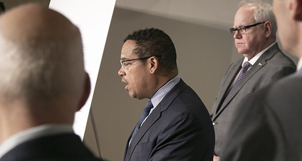 Attorney General Keith Ellison addresses reporters at a press conference where Gov. Tim Walz, right, declared a state of emergency for Minnesota to facilitate rapid response to the COVID-19 crisis. (Staff photo: Kevin Featherly)