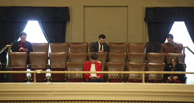 In this March 26 photo, several Lawmakers in the Minnesota House practice social distancing from a gallery at the State Capitol in St. Paul as representatives take up bills related to the coronavirus in the state. (AP photo: Jim Mone)