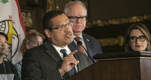 Attorney General Keith Ellison, shown in this December 2019 photo with Gov. Tim Walz and Lt. Gov. Peggy Flanagan, said Monday that his office is stepping up its efforts to enforce the governor's anti-eviction order. (File photo: Kevin Featherly)