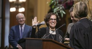 On Jan. 16, newly appointed Court of Appeals Judge Susan Segal took the oath of office from her predecessor, retired Judge Jill Faskamp Halbrooks. Segal's husband, MMB Commissioner Myron Frans, watched in the background. (File photo: Kevin Featherly)