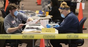 Milwaukee Election Commission workers process absentee ballots in Wisconsin's presidential primary election Tuesday in Milwaukee. (Milwaukee Journal-Sentinel via AP)