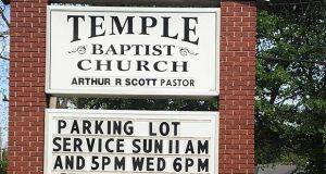 This image provided by Alliance Defending Freedom shows the sign for parking lot church services outside of Temple Baptist Church in Greenville, Mississippi, on April 9. (Alliance Defending Freedom via AP)