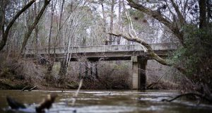 This photo, made in February 2018, shows a bridge that spans the Apalachee River at Moore's Ford Road, where in 1946 two young black couples were stopped by a white mob who dragged them to the riverbank and shot them multiple times in Monroe, Georgia. (AP file photo: David Goldman)