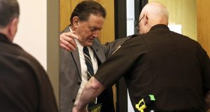 Authorities wand Byron Smith, left, as he enters Morrison County Courthouse on Tuesday, April 29, 2014, in Little Falls, Minnesota. Smith shot and killed two teenagers during a 2012 Thanksgiving Day break-in, and he was convicted of premeditated murder. (AP file photo: Star Tribune)