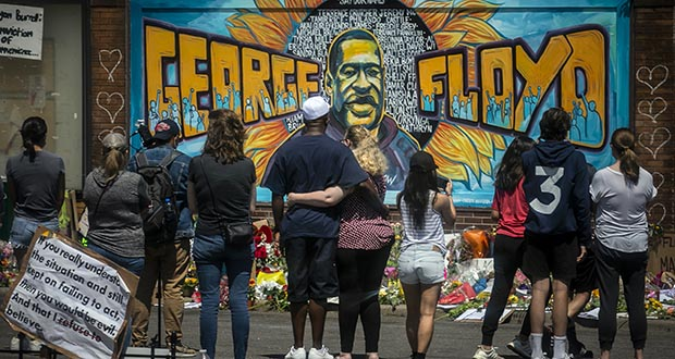 Visitors make silent visits Sunday to organic memorial featuring a mural of George Floyd, near the spot where he died while in police custody in Minneapolis. (AP photo: Bebeto Matthews)