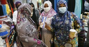 Visitors to Karmel Plaza wear face masks as they gather July 22 in Minneapolis. Gov. Tim Walz has issued a statewide mandate requiring Minnesotans to wear masks in indoor public spaces. (AP photo: Jim Mone)