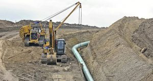 Heavy equipment was seen Oct. 5, 2016, at a site where sections of the Dakota Access pipeline were being buried near the town of St. Anthony in Morton County, North Dakota. A federal judge on Monday sided with the Standing Rock Sioux Tribe and ordered the Dakota Access pipeline to shut down until more environmental review is done. (The Bismarck Tribune via AP)