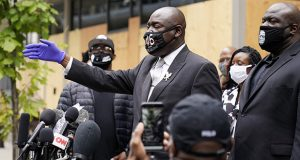 Attorney Ben Crump, representing George Floyd's family, addresses the media after a hearing at the Hennepin County Family Justice Center on Friday in Minneapolis for four former Minneapolis Police officers who are charged in the death of Floyd. With Crump are members of Floyd's family. (AP photo: Jim Mone)