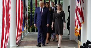 President Donald Trump walks along the White House Colonnade with Judge Amy Coney Barrett to a news conference to announce Barrett as his nominee to the Supreme Court on Saturday. (AP photo: Alex Brandon)