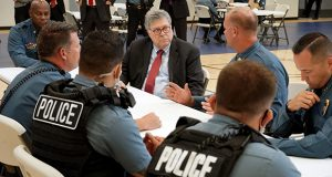 Attorney General William Barr participates in a roll call Aug. 19 with police officers from the Kansas City Police Department in Kansas City, Missouri. (AP file photo)
