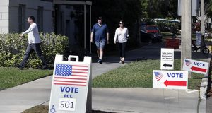 Voters head to a polling station to vote in Florida's primary election March 17 in Orlando. (AP file photo)