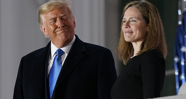 President Donald Trump and Justice Amy Coney Barrett stand on the Blue Room Balcony after Justice Clarence Thomas administered the constitutional oath to her on the South Lawn of the White House in Washington on Monday. (AP photo)