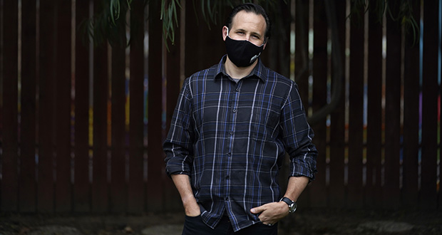 Nicholas Philbrook, shown Nov. 18 in his backyard in Camarillo, California, has been trying to convince court officials that he should be excused from jury duty because his father-in-law, a cancer survivor with diabetes, lives with his family. (AP photo: Marcio Jose Sanchez)