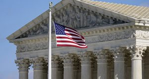 A flag waves in front of the Supreme Court building on Capitol Hill in Washington. (AP file photo)