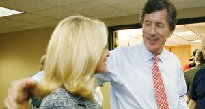 In this 2007 file photo, then-U.S. Rep. Jim Ramstad prepares to leave a news conference with his wife, Kathryn, in Minnetonka. (AP file photo)