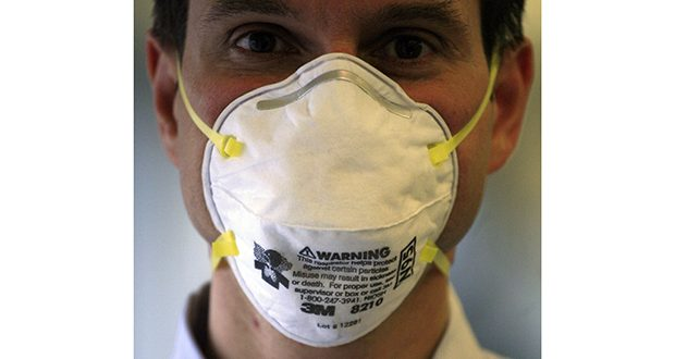 A 3M N95 mask is modeled in New York in this 2009 photo. (AP file photo)