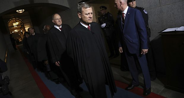 Supreme Court Chief Justice John Roberts, right, and Justice Anthony Kennedy arrive on the West Front of the U.S. Capitol in Washington for Donald Trump's inauguration ceremony Jan. 20, 2017. (AP file photo)