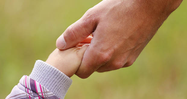 STOCK parent holding child's hand
