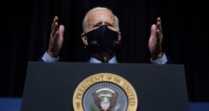 President Joe Biden speaks Feb. 11 during a visit to the Viral Pathogenesis Laboratory at the National Institutes of Health in Bethesda, Maryland. A federal judge late Tuesday indefinitely banned Biden's administration from enforcing a 100-day moratorium on most deportations. (AP file photo)