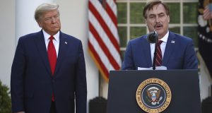 MyPillow CEO Mike Lindell speaks as President Donald Trump listens during a briefing about the coronavirus in the Rose Garden of the White House on March 30, 2020, in Washington. (AP file photo)