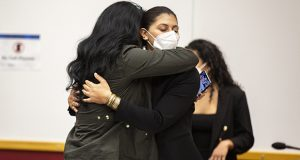 Des Moines Register reporter Andrea Sahouri, facing, hugs her mother, Muna Tareh-Sahouri, after being found not guilty at the conclusion of her trial at the Drake University Legal Clinic on Wednesday in Des Moines, Iowa. (The Des Moines Register via AP, pool)