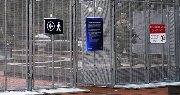 A National Guard soldier walks inside the fenced-off plaza of the Hennepin County Government Center on Wednesday as the trial of former Minneapolis police officer Derek Chauvin continues with jury selection. Chauvin is charged with murder in the death of George Floyd during an arrest last may in Minneapolis. (AP photo: Jim Mone)