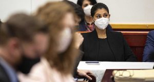 Des Moines Register reporter Andrea Sahouri listens to opening statements in her trial in which she is charged with failure to disperse and interference with official acts while reporting on a protest last summer, Monday, March 8, 2021, at the Drake University Legal Clinic, in Des Moines, Iowa. (The Des Moines Register via AP)