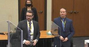 In this image taken from video, defense attorney Eric Nelson, left, and defendant Derek Chauvin, right, and Nelson's assistant Amy Voss, back, introduce themselves to potential jurors as Hennepin County Judge Peter Cahill presides Monday at the Hennepin County Courthouse in Minneapolis. (Court TV, Pool via AP)