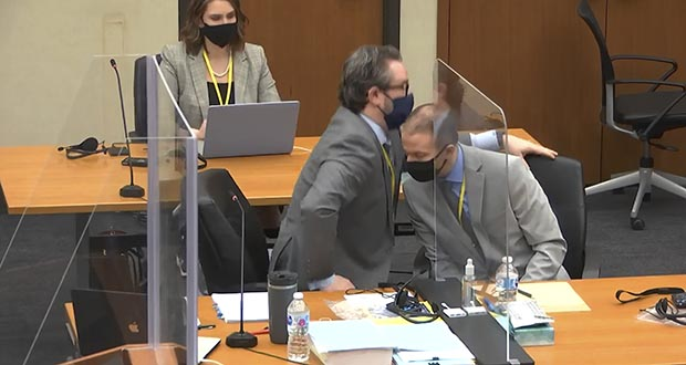 Clear plastic sheets run down the middle of the defense and prosecution tables. When defendant Derek  Chauvin and defense attorney Eric Nelson want to confer, they need to lean or step back a bit. In this image from video, Nelson, left, and Chauvin confer Tuesday. (Court TV via AP, pool)