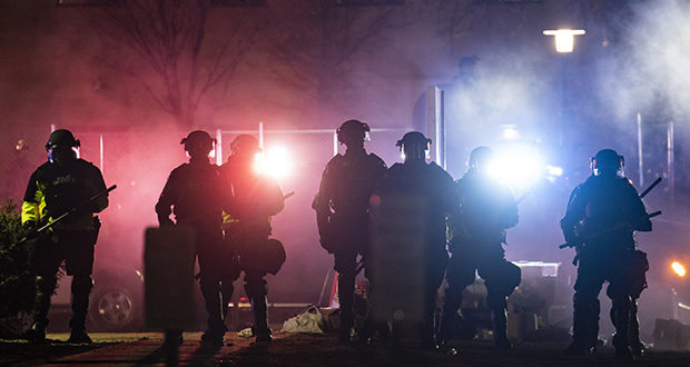 Law enforcement officers clear an area of demonstrators outside the Brooklyn Center Police Department during a protest Wednesday over last week's fatal shooting of Daunte Wright during a traffic stop in Brooklyn Center. (AP Photo: John Minchillo)