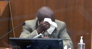 In this March 31 image from video, witness Charles McMillian becomes emotional as he answers questions at the trial of former Minneapolis police officer Derek Chauvin in the Hennepin County Courthouse in Minneapolis. (Court TV via AP, pool)