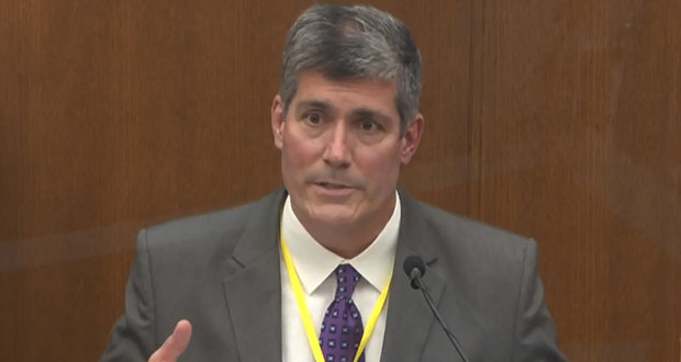 In this image from video, Dr. Andrew Baker, Hennepin County medical examiner, testifies Friday, April 9, in the trial of former Minneapolis police officer Derek Chauvin at the Hennepin County Courthouse in Minneapolis. (Court TV via AP, Pool)