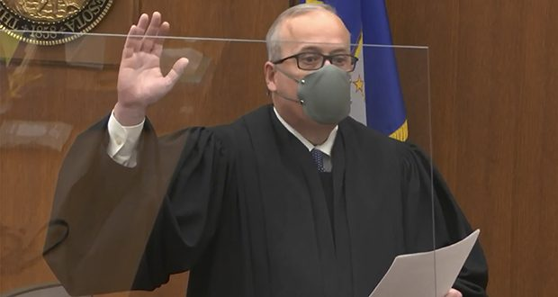 In this image from video, Hennepin County Judge Peter Cahill swears in the jury  Monday, March 29, for the trial of former Minneapolis police officer Derek Chauvin in the death of George Floyd. The state Supreme Court ruling in State v. Coleman could affect instructions to the jury in Chauvin's trial. (Court TV via AP, pool)