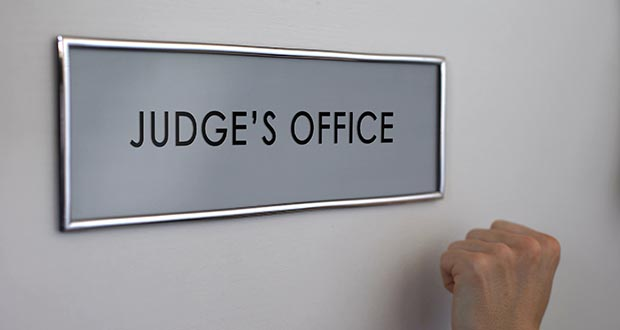 Judge office door, lawyer hand knocking closeup, court hearing, justice system