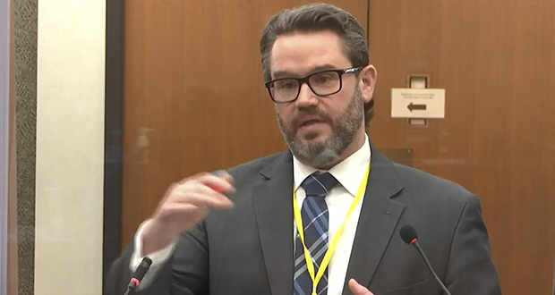 In this image from video, defense attorney Eric Nelson questions Dr. Andrew Baker, Hennepin County Chief Medical Examiner, on Friday, April 9, in the trial of former Minneapolis police officer Derek Chauvin at the Hennepin County Courthouse in Minneapolis. (Court TV via AP, Pool)