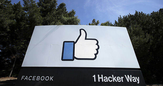 """Facebook's thumbs-up """"Like"""" logo is seen April 14, 2020, on a sign at Facebook headquarters in Menlo Park, California. (AP file photo)"""