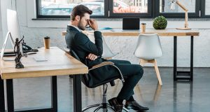 Burned-out man at office chair