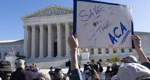 A demonstrator in front of the U.S. Supreme Court