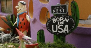 A statue of Fred Flintstone stands near the front entryway of the Flintstone House in Hillsborough, California, in this April 11, 2019 photo. (AP file photo: Eric Risberg)