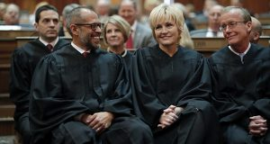 In this Jan. 14, 2020, photo, Iowa Supreme Court Justices Christopher McDonald, left, Susan Christensen, center, and Edward Mansfield, right, attend Iowa Gov. Kim Reynolds' Condition of the State address at the Statehouse in Des Moines, Iowa. (AP file photo)