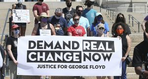 In this June 12, 2020, file photo, protesters demanding change in the wake of the death of George Floyd hold a media briefing outside the Minnesota State Capitol in St. Paul. (AP file photo: Jim Mone)
