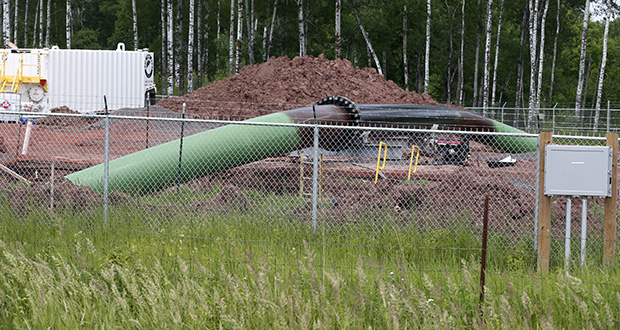 An Enbridge Energy pipeline drilling pad is shown in this June 29, 2018, file photo along a rail line that traces the Minnesota-Wisconsin border near Cloquet, Minnesota. (AP photo: Jim Mone)