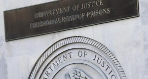 sign for the Department of Justice Federal Bureau of Prisons