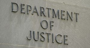 This photo shows a sign outside the Robert F. Kennedy Department of Justice building in Washington. (AP file photo)