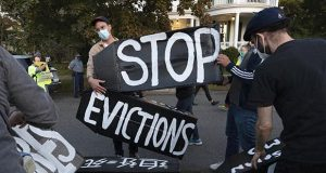 """Housing activists erect a sign reading """"Stop evictions"""""""