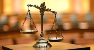 Photo of scales of justice on a desk