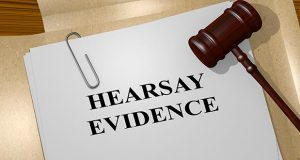 3D illustration of 'HEARSAY EVIDENCE' title on legal document