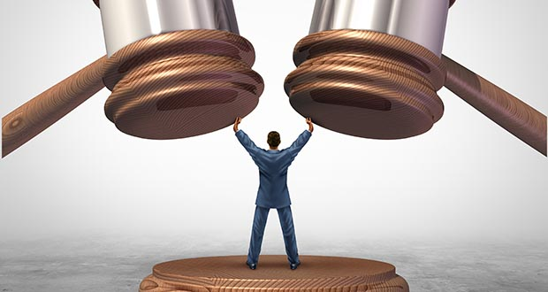 Illustration of a man separating two judge mallets or gavel as competitors in arbitration.